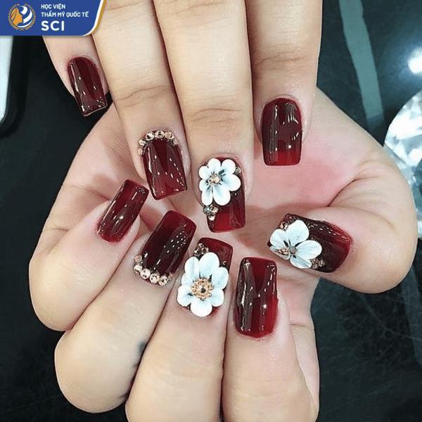 Mẫu nail đính đá màu đỏ rượu vang đơn giản mà quyến rũ - hoidapnails.com