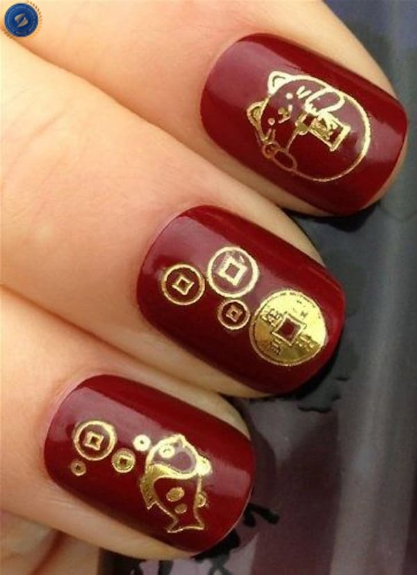 Mẫu nail đón tết trên nền đỏ đô - hoidapnails.com