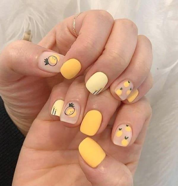 Mẫu nail cute dễ thương với hoạ tiết quả dứa - hoidapnails.com