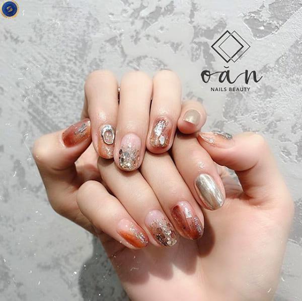 Mẫu nail tết dành cho các cô gái thích gam màu ấm - hoidapnails.com
